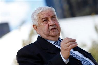 Syrian Foreign Minister Walid al-Moallem gives an interview during the 68th session of the United Nations General Assembly at U.N. headquarters, Saturday, Sept. 28, 2013.