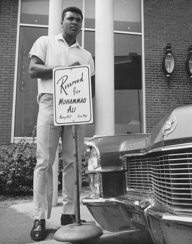 Muhammad Ali stood behind the sign reserving his parking place at the former Schine Inn, Chicopee, when he trained there in 1965. the hotel, now known as the Plantation Inn, goes on the auction block Friday
