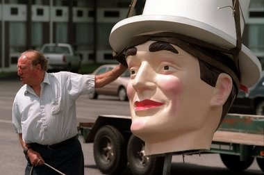 The late Mario P. Cantalini in 1999 with the head of his Plantation Man. Cantalini was in the act of moving the statue from his former business, Mutual Ford in Springfield .