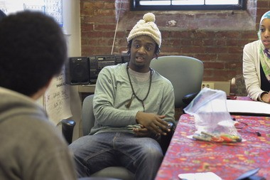 Talib Toussaint, program director at Garden the Community, works with youth leaders for the Garden the Community Eats summer program in the organization's Springfield office.
