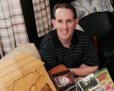 Former Holyoke Mayor Daniel J. Szostkiewicz shows off items he got form a visit to the Ukraine in 1997. Szostkiewicz established a sister-city with Svalyava in far western-Ukraine.