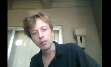 Barrett Brown is pictured in a YouTube video in which he made threats against an FBI agent.