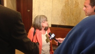Michaelann Bewsee talks to reporters following Wednesday's Springfield City Council meeting.