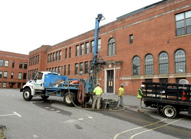 Workers from Seaboard Drilling Inc. Nov. 5 perform soil testing at the site of the former Howard Street School, which will be the MGM parking garage used for their project.