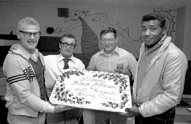 Floyd Patterson, right, former world heavyweight champion, brought his amateur team out of New Paultz, N.Y., to Holyoke for several special contests during the early to mid-1980s. During one trip he was honored by the club with a cake and dinner. From left, Matt Baranski, coach of the Albany, N.Y., Trinity club boxing team; Golden Gloves Director Nick Cosmos, and committeeman Ray Narey. Undated photo.