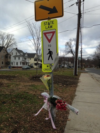 Flowers adorn the site where Patricia Welker, a 76-year-old crossing guard, was hit by an SUV on Monday, Dec. 15, 2014. She later died of her injuries. Dec. 18, 2014.