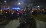 Police estimated 300 people attended a candlelight vigil Monday (Dec. 22) on the 15th anniversary of the death of Holyoke Police Officer John A. DiNapoli. The event was held at the statue to DiNapoli (foreground) that was erected across from the Police Station, 138 Appleton St.