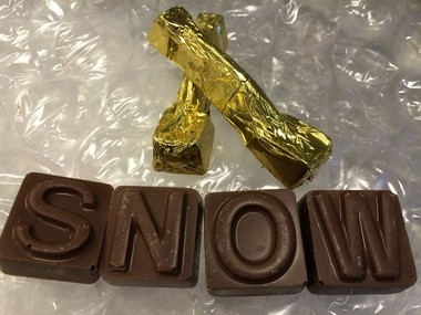 The box comes with two chocolate snow shovels.