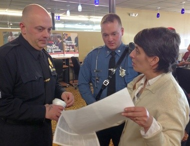 Sgt. Brian Beliveau, left, and state trooper Jon Blanchard listen as Sheri Kurtz, clinical director for Tapestry Health's LaVoz Program, talks about the South End. Beliveau and Blanchard are part of the newly expanded C-3 unit assigned to the South End.