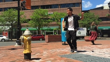 Desmond Ashwell dances in downtown Springfield.