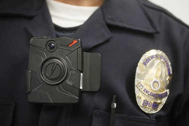 "In this Jan. 15, 2014 file photo a Los Angeles Police officer wears an on-body camera during a demonstration for media in Los Angeles. Nearly three dozen advocacy groups have released principles they want police agencies to follow when adopting body cameras. The groups say the five ""civil rights principles"" released Friday, May 15 would help ensure the cameras provide public accountability and transparency. Groups include the American Civil Liberties Union, chapters of Asian Americans Advancing Justice and Urbana Champaign Independent Media Center. (AP Photo/Damian Dovarganes,File)"