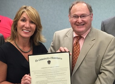 Agawam Mayor Richard A. Cohen and Lt. Gov. Karyn Polito pose with the community compact agreement between the city and the state, signed Wednesday.