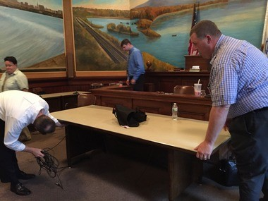 Holyoke city councilors Todd A. McGee, left, and Kevin A. Jourdain move a table in City Council Chambers at City Hall Monday (June 29) to accommodate a training session councilors received.