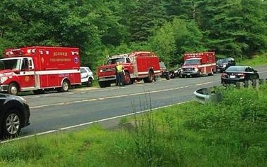 7-2-15 -- Southwick -- Emergency vehicles at the scene of the rescue of 17-year-old Antonio Bruno who fell 60 feet or more in an abandoned quarry near the Agawam town line.