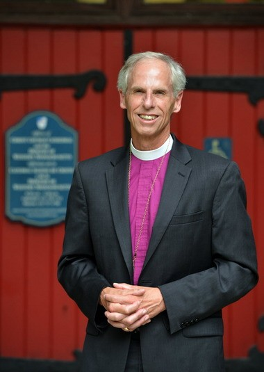 Bishop Fisher in front of Christ Church Cathedral.