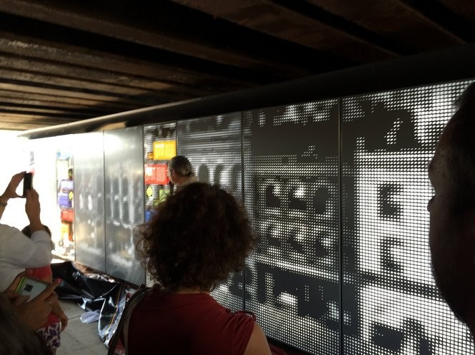 "A 30-foot-long, illuminated public art piece called ""Arrivals"" was unveiled Wednesday (Aug. 19) under the Mosher Street Rail Bridge in Holyoke to a crowd of adults and children."