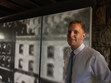 "Holyoke Mayor Alex B. Morse at the presentation Wednesday (Aug. 19) of the public art installation ""Arrivals"" under the Mosher Street Rail Bridge."