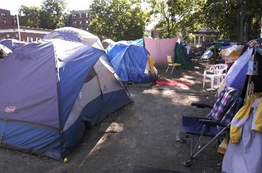 """This 2004 file photo shows a portion of the Springfield """"Tent City."""" These tents are pitched on School Street behind the Open Pantry Community Services building which faces State Street."""