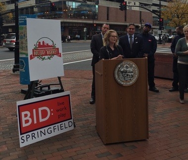 Interim Director of the Springfield Central Cultural District Morgan Drewniany speaks at the announcement of the Downtown Holiday Market.