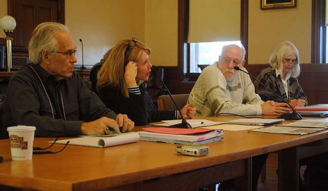 WiredWest board members Steve Nelson, Monica Webb (chair), Jim Drawe, and Becky Torres at a Dec. 5 emergency meeting at the old Hampshire County courthouse in Northampton.