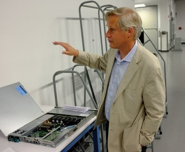 Executive Director John T. Goodhue discusses components of the Massachusetts Green High Performance Computing Center in a tour Sept. 2, 2015.