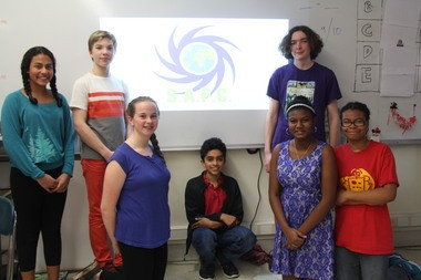 Amherst Regional Middle School students involved in change Columbus Day to Indigenous People's day movement. From left, Aarti Lamberg, Innis Gallagher, Hillary Atkinson (kneeling), Mohan Setty-Charity (center), Melinda Medwinter(kneeling), Jesse Barker Plotkin (standing, behind), Kelly Brown (far right).