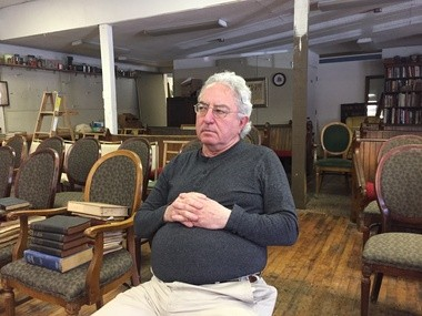 HUNTINGTON - David Baillargeon, an ordained deacon with Holy Family Church in Russell, listens as friend and activist Olan Horne weighs in on the Springfield Catholic Diocese's handling of a recent abuse case.