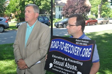 Robert Hoatson of Road to Recovery, left, and Bill Nash of Ashfield, speak to the press on a sidewalk at Deerfield Academy on Wednesday. The school settled a lawsuit by a former student who said he was raped at age 14 by a Deerfield faculty member.