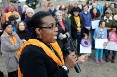 Amherst Regional High School teacher Carolyn Gardner speaks at community vigil on the Amherst Town Common in April 2014.