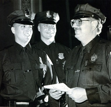 Police Det. Gregg Bigda is shown here, center, at the 1994 Police Academy graduation ceremony in Holyoke.