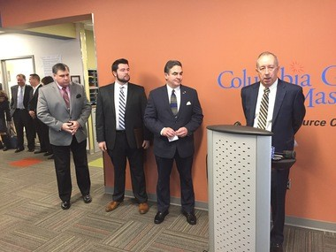Steve Bryant, president of Columbia Gas, at podium, announces plans to accelerate repairs of gas leaks in the region. Looking on, left to right, are Springfield Public Works Director Christopher Cignoli, Jesse Lederman of Arise for Social Justice and Mayor Domenic J. Sarno.