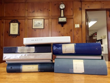 Binders containing Longmeadow Select Board minutes from the 1980s, 1990s and 2005 in a conference room at the town's 20 Williams St. offices.