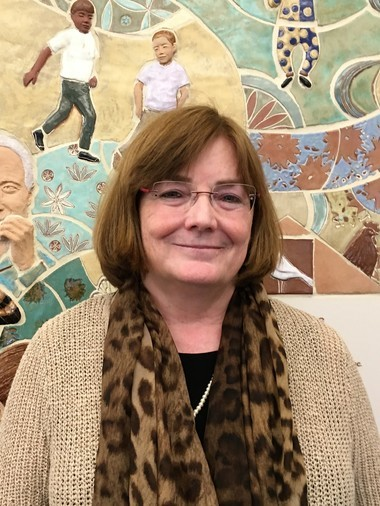 """Elizabeth G. Dineen, the former Hampden County assistant district attorney who now heads the YWCA of Western Massachusetts, calls YouthBuild Springfield graduate Joseph LaBelle """"an amazing success story"""" and one that she hopes will """"inspire others to enroll here."""""""