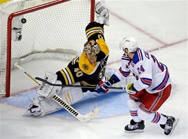 Boston Bruins netminder Tuukka Rask makes a save on New York Rangers' Ryan Callahan in Game 5 of their Eastern Conference semis series.