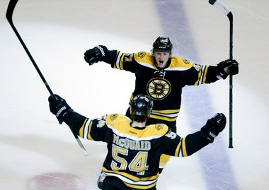 Boston Bruins defenseman Adam McQuaid celebrates his goal with Torey Krug in the third period of Game 4 of the Eastern Conference final.