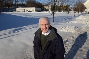 Economic Development Coordinator Terry Masterson at site of new hotel on Conz Street.