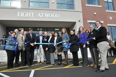 Ribbon-cutting at new professional building on Atwood Drive.