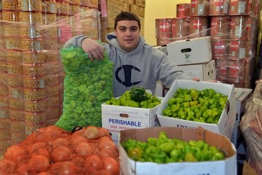 Latino Food Distributors manager Michael Vallides with some the fresh ingredients used in the products made at the 89 Baldwin St., West Springfield facility.
