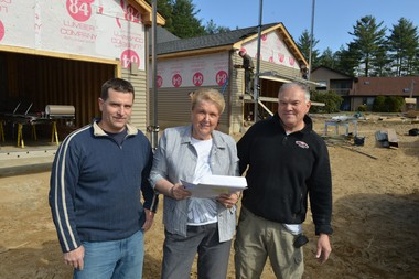 Scott Hathaway, left, of S. Hathaway Construction Co., and John Pirog, right, of J. P. Builders Inc., are in a joint venture to build condominiums at 929 Shaker Road in Westfield with the help of their project manager, Priscilla Harman of Real Living Realty.