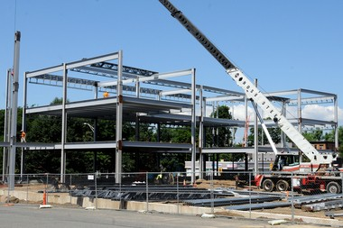 06/19/13 Springfield - Republican Photo by MARK M. MURRAY - Steelwork is being put up on the 75,00 square foot three story outpatient medical office center at Carew and Chestnut Streets . The Sisters of Providence and Hampden County Physician Associates are partners in the effort in the project which being built on the outer parking lot of Mercy Medical Center.