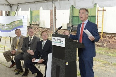 U.S. Rep. Richard E. Neal, D-Springfield, speaks during the Westmass Area Development Corporation EPA Brownfields grant award ceremony Monday at the Ludlow Mills preservation and redevelopment project. Listening from left: Kenn W. Delude, Westmass president, William Rooney, chair of the Ludlow Board of Selectmen, and John Maybury, chairman of Westmass.
