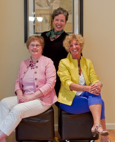 Color consultant Amy Woolf, standing. Liz Provo, a marketing consultant, left, and Donna Hebert, a stager. The three, and the woman who took the photo, Lisa Joy Merrill, are members of the Women Business Owners Alliance and collaborated in a successful project.