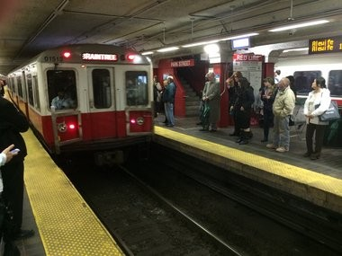 A Red Line train pulls into the MBTA Park Street station. A Chinese company, Changchun Railway Vehicles Co. hopes to build replacement Red and Orange Line cars in Springfield.