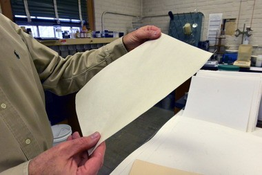 PaperLogic Mill manager and technical director Kenneth Schelling holds a piece experimental nanofiber composite paper that is being developed at the company.
