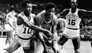 JoJo White plays defense during his time with the Boston Celtics.