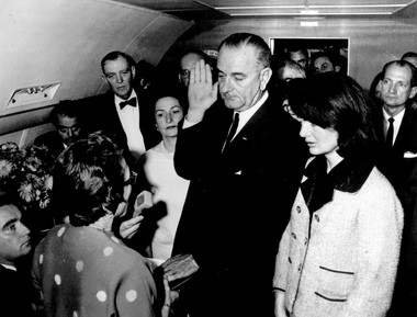 In this Nov. 22,1963, file photo, provided by the White House, Lyndon B. Johnson is sworn in as President of the United States in the cabin of Air Force One as Jacqueline Kennedy stands at his side. Judge Sarah T. Hughes, a Kennedy appointee to the Federal court, left, administers the oath. (AP photo)