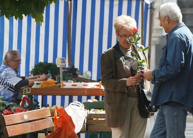 A man offers a rose to a woman in the capital city's trendy Savior Square in Warsaw, Poland.