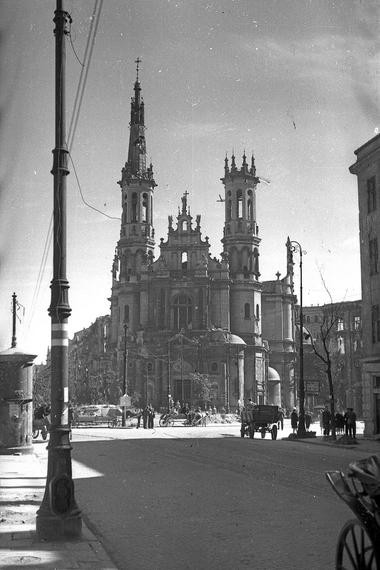In this 1940s photo, the ruins of Marszalkowska street, leading into Savior Square are shown after World War II in Warsaw, Poland. One of the spires of the damaged Church of the Holiest Savior is seen in the background.