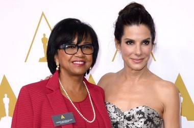 President of the Academy Cheryl Boone Isaacs and Oscar winning actress Sandra Bullock arrive at the 86th Oscars Nominees Luncheon, on Feb., 10, 2014 in Beverly Hills, Calif. (AP photo)