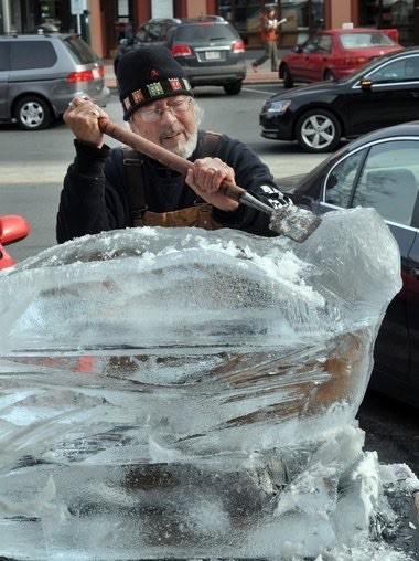 Greg Stone carves an owl during the 2012 Ice Art Festival
